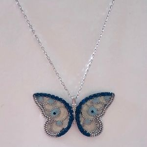 Silver baby blue  butterfly eye necklace